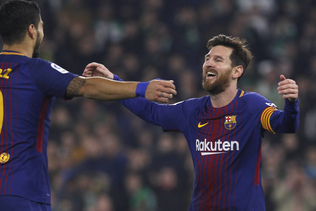 Des doublés pour Messi et Suarez