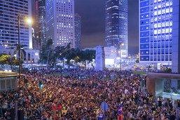 La police de Hong Kong dit pouvoir gérer les manifs sans Pékin
