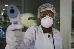 Coronavirus: plus de 250 morts, la Chine de plus en plus isolée