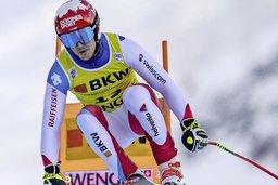 Loïc Meillard au pied du podium